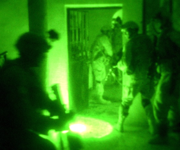 Seen through a night-vision device, paratroopers conduct a raid on a suspected terrorist's home in Fallujah, Iraq. The Soldiers are assigned to the 82nd Airborne Division's Company B, 1st Battalion, 505th Parachute Infantry Regiment.