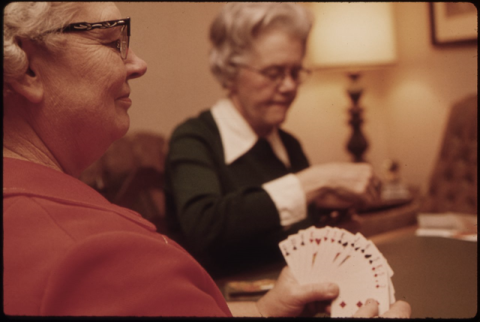 two older ladies playing cards